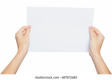 Female hands holding a blank paper sheet, isolated on white. Clipping path