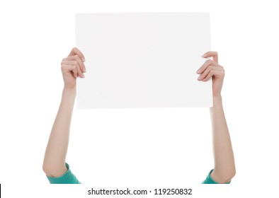 Female hands holding a blank white paper isolated over white background