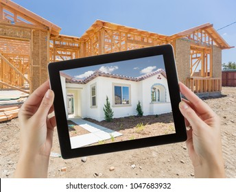Female Hands Holding Computer Tablet with Finished House on Screen, Construction Framing Behind.