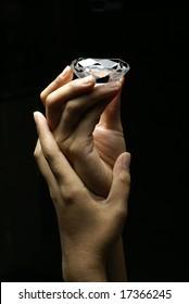 Female hands holding diamond