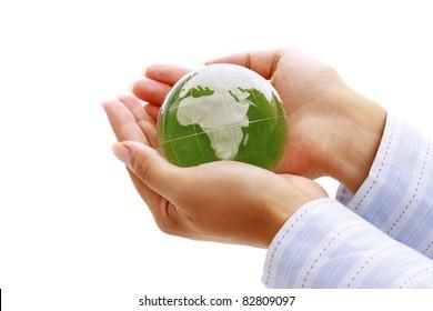 Female hands holding a glass globe