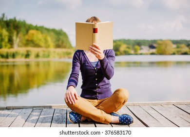 female hands holding open book. Reading concept background