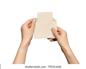 Female hands holding open vintage envelope, isolated on white