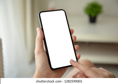 female hands holding phone with isolated screen in room in the house