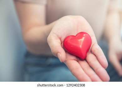 Female hands holding red heart, Love concept for valentines day with sweet and romantic moment.
