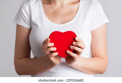 Female hands holding red heart, Love concept for valentines day with sweet and romantic moment