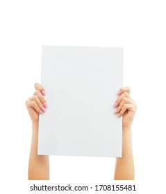 Female hands holding and rise up blank sheet poster for copy-space and mockup on a white background.