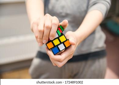 female hands holding a rubik's cube