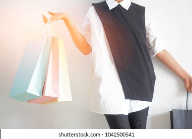 Female hands holding a shopping bags, beautiful girl with shopping bags doing shopping in the mall.