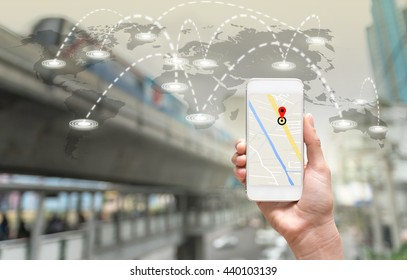 female hands holding a smart phone showing part of navigator map on connection line over the world map with blurred photo of traffic jam, Navigation concept,Elements of this image furnished by NASA