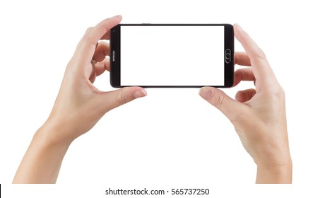 Female Hands Holding A Smart Phone with Blank Screen Isolated on a White Background.