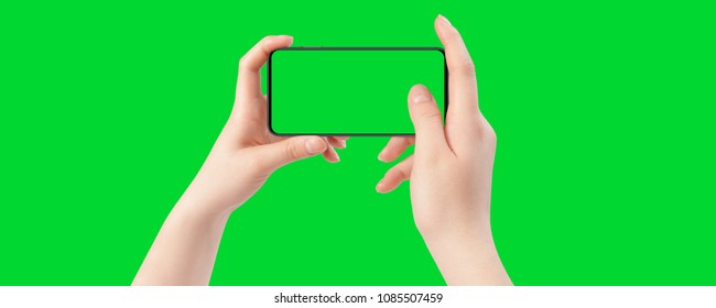 Female hands holding smartphone with empty screen, isolated on green background. The chromakey. Green screen.