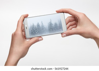 Female hands holding smartphone with picture on screen. Mobile photography concept, focus on screen and fingers. Screen isolated with clipping path
