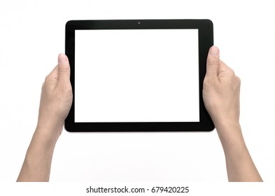 Female hands holding a tablet pc touch computer with blank screen isolated on white background.