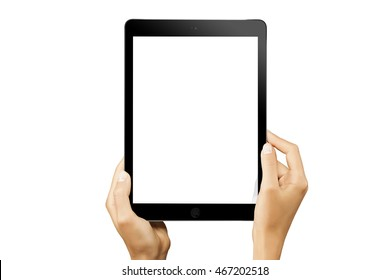 Female hands holding vertical black tablet with white screen isolated at white background.