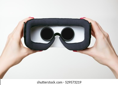 Female hands holding virtual reality googles, VR, white background