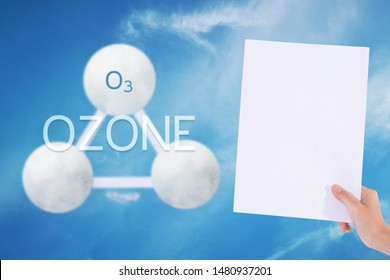 Female hands holding white paper with sign ozone o3 in blue sky background./Ozone concept