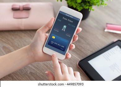 female hands holding white phone with online train ticket and e-rider