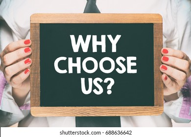 Female hands holding wooden blackboard / Female hands holding wooden blackboard with text why choose us ?