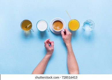 Female Hands Holds Group Useful Colorful Beverages Drink Coffee Milk Tea Orange Juice Water Flat Lay Still Life Table Top View Blue Background