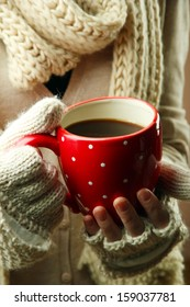 Female hands with hot drink, close-up