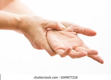 female hands make acupressure on the arm,