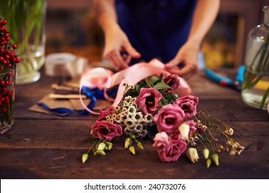 Female hands making a bouquet