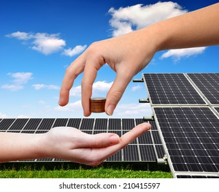 Female hands with money.In the background solar panel.