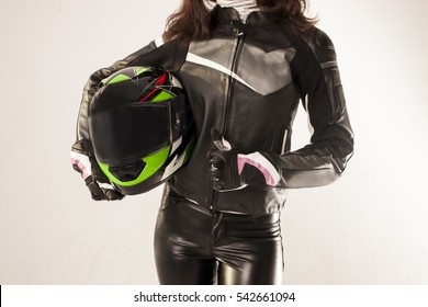 female hands in motorcycle gear holding motorcycle helmet and thumb up compliance with safety rules on road contest sign up Motorcycle Riders Gear Motorcyclist with helmet in his hands.