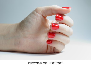 Female hands and nails are done. Long nails might be unsafe and carry on bacterias. Short nails are healthier