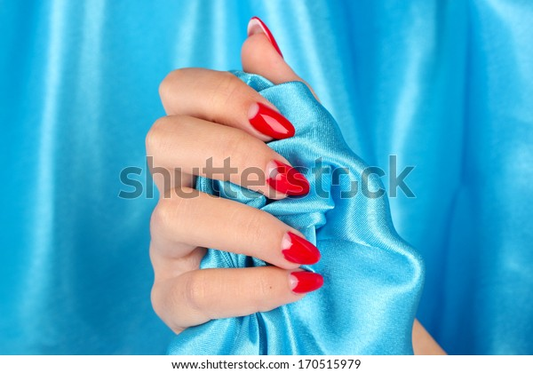 female hands on background color fabric