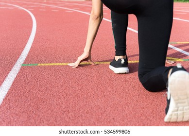 Female Hands on starting line waiting for the start in running track, workout session