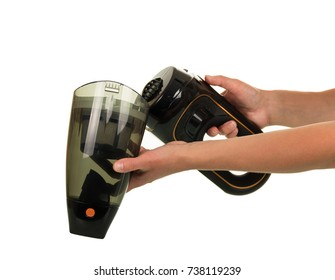 Female hands open car vacuum cleaner isolated on white background