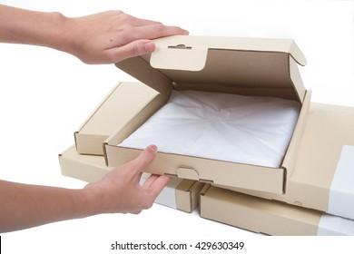 Female hands opening box isolated on white background