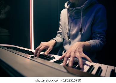 Female hands play the piano. Concept of music recording, rehearsal or live performance.