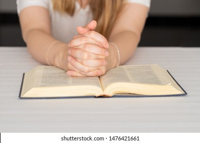 Female hands  in player on Bible. Woman praying and ask God for help. Faith, spirtuality and religion background.