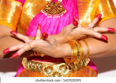 Female hands of professional Indian dancer demonstrates dance mudra (gesture) of Bharatanatyam classical dance in closeup view