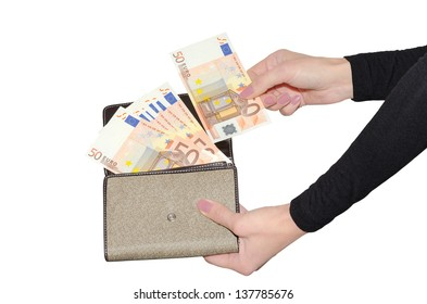Female hands pulling out banknote from purse with fan of fifty euro banknotes isolated