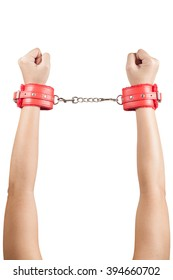 female hands in red leather handcuffs