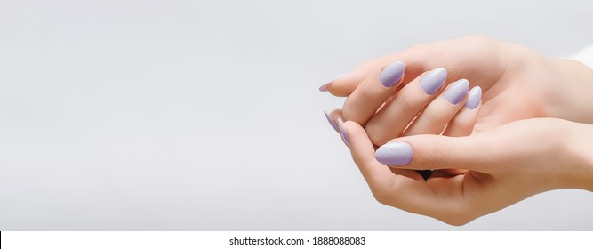 Female hands with rose nail design. Pink glitter nail polish manicure on white background. Nail design copy space