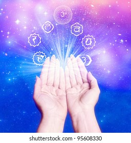 female hands with seven symbol of chakra like a conncept for healing energy