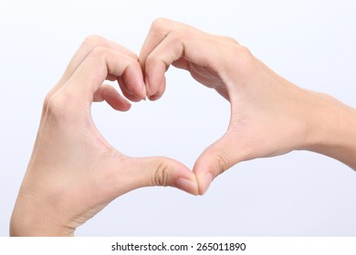 Female hands shaping a heart symbol on white background