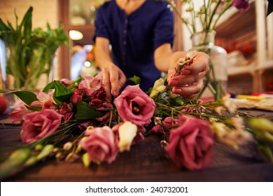 Female hands sorting flower for bouquet