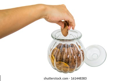 Female hands taking a cookie from a cookie jar