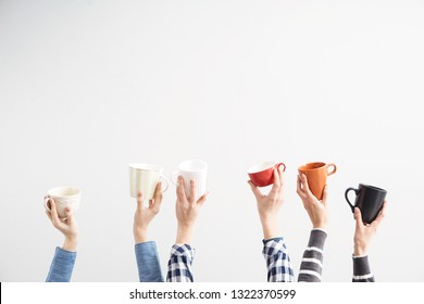 Female hands with tea cups on light background
