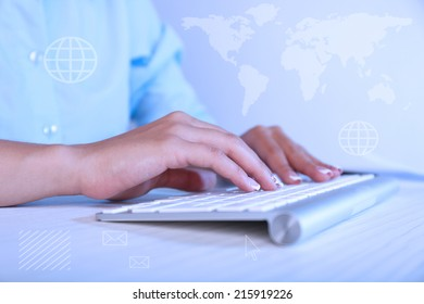 Female hands typing on keyboard, on light background