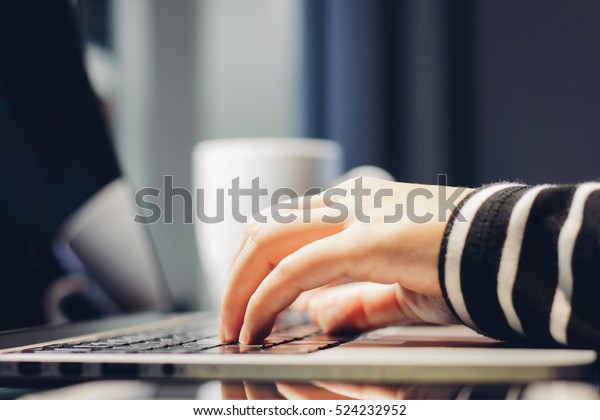 Female hands typing on keyboard of computer laptop, work from home and self quarantine concept, prevent spread of pandemic Covid-19 and Coronavirus