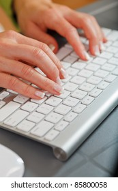 Female hands typing on modern keyboard