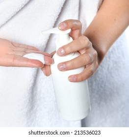 Female hands using cosmetic liquid soap or hand sanitizer close up
