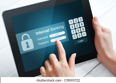 Female hands using internet banking on  tablet pc